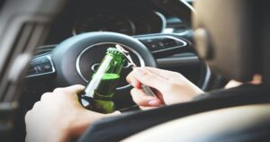 reckless driving opening alcohol bottle